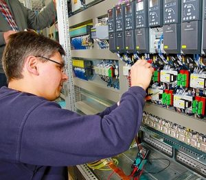 man working at control panel